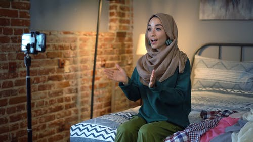 Woman in Brown Hijab Doing a Product Video Blog