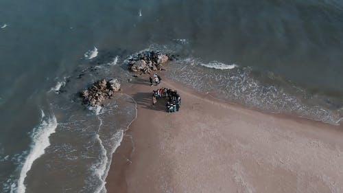 People Gathering On The Seashore