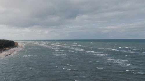 Ripples Of Sea Waves Running Towards The Shore