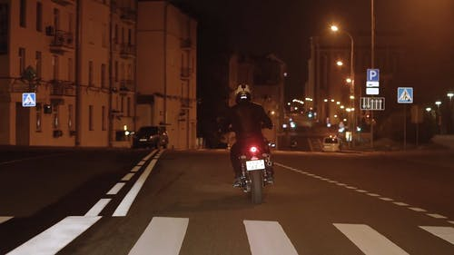 Person Riding a Motorcycle at the City
