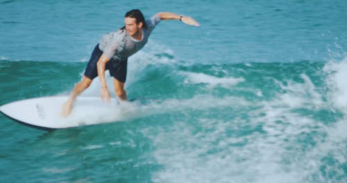 A Male Surfer Riding Skillfully The Sea Waves