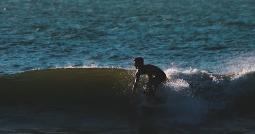 A Man Surfing The Sea Waves