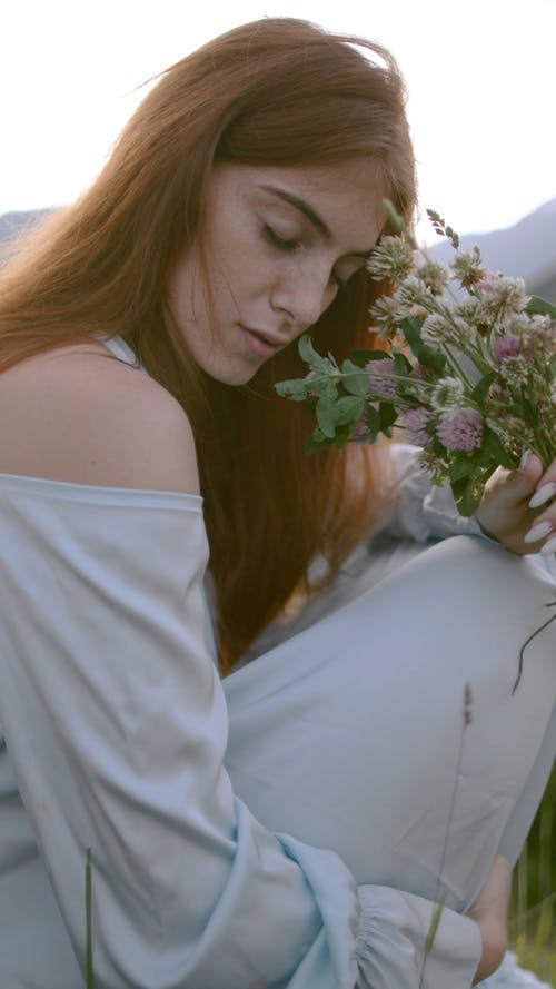 Woman Holding a Flowers