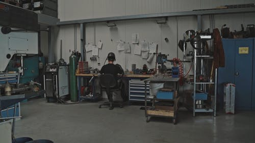 A Person in a Workshop