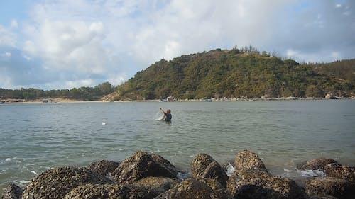 Men Fishing on the Sea
