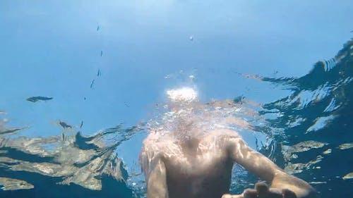Person Swimming in the Sea