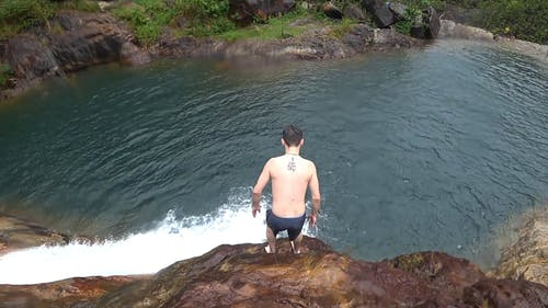 Man Jumping on the Cliff