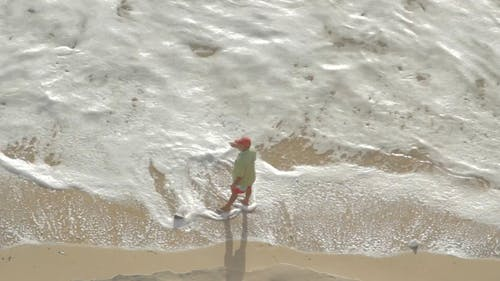 Top View of a Person Standing on Beach Shore