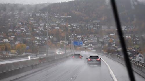 Vehicles Traveling on Expressway While Raining