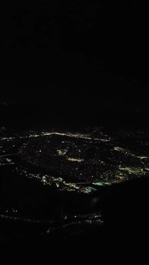 Airplane Landing at the Airport at the Night Time