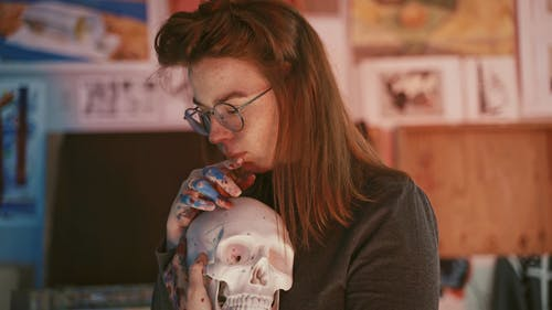 Woman Holding a Skull