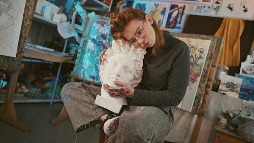 Woman Holding a Gypsum Head