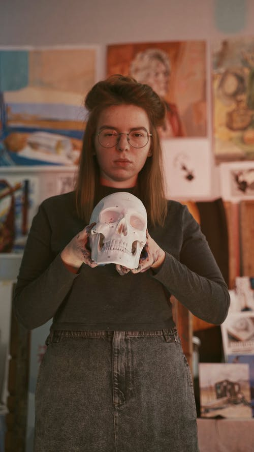 A Woman Holding a Skull