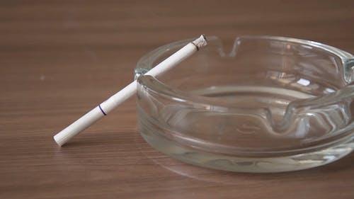 Burning Cigarette on an Ashtray