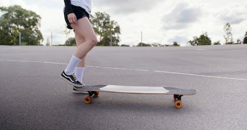 Girl Holding a Skateboard