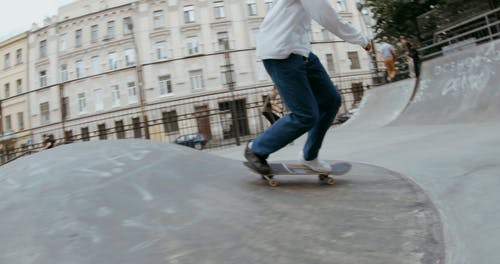 People Playing Skateboard at the Playground
