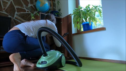 Video Of Woman Cleaning The House Using Vacuum