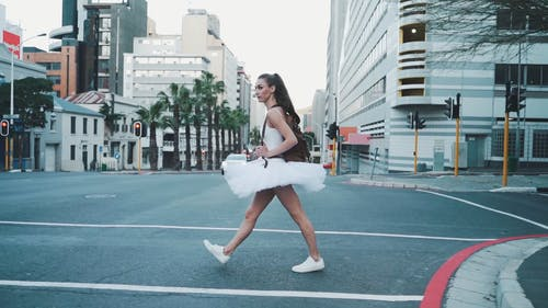 Woman in Ballerina Costume Crossing the Street