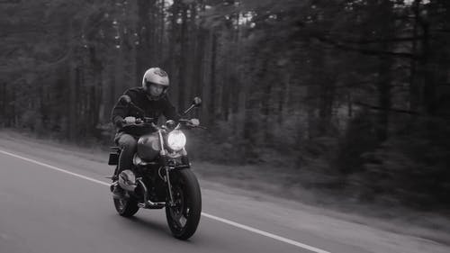 Man on Cafe Racer Motorcycle