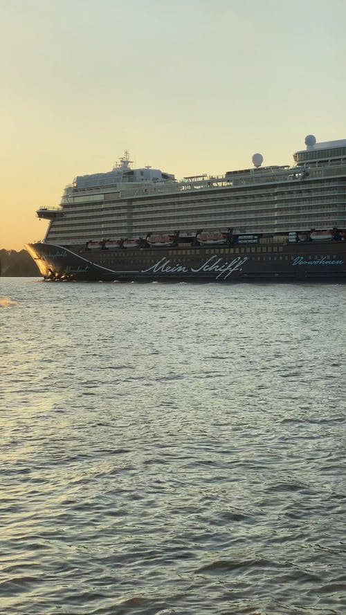 Passenger Ship passing by Mein Schiff Cruise Ship