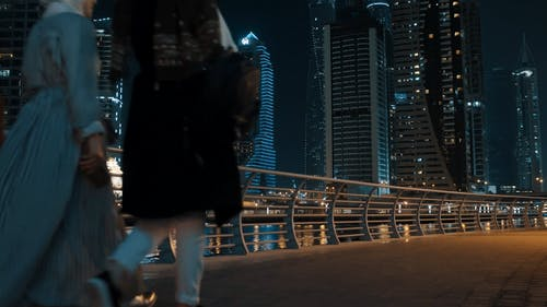 Women in Hijab Passing by Bridge