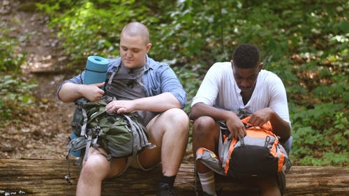 Two Guys Checking their Backpacks