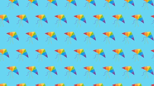 Colorful Kites on Blue Background