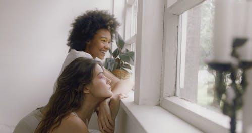 Women Looking Outside the Window