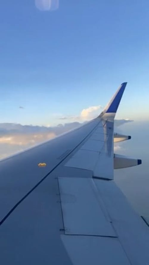 View of Flying Airplane Wing