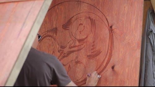 Man Working over his Art Piece
