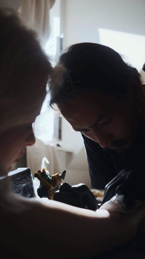 Man Working on a Tattoo