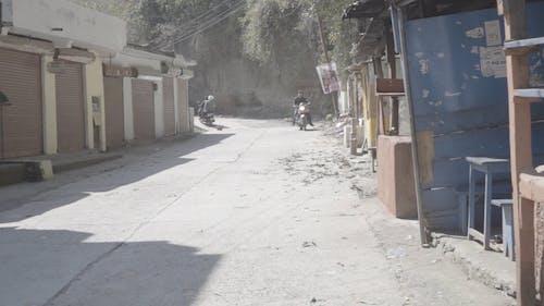 Traveler Van Passing through Tight Indian Roads in Mountains