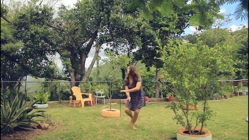 Woman Dancing in the Garden