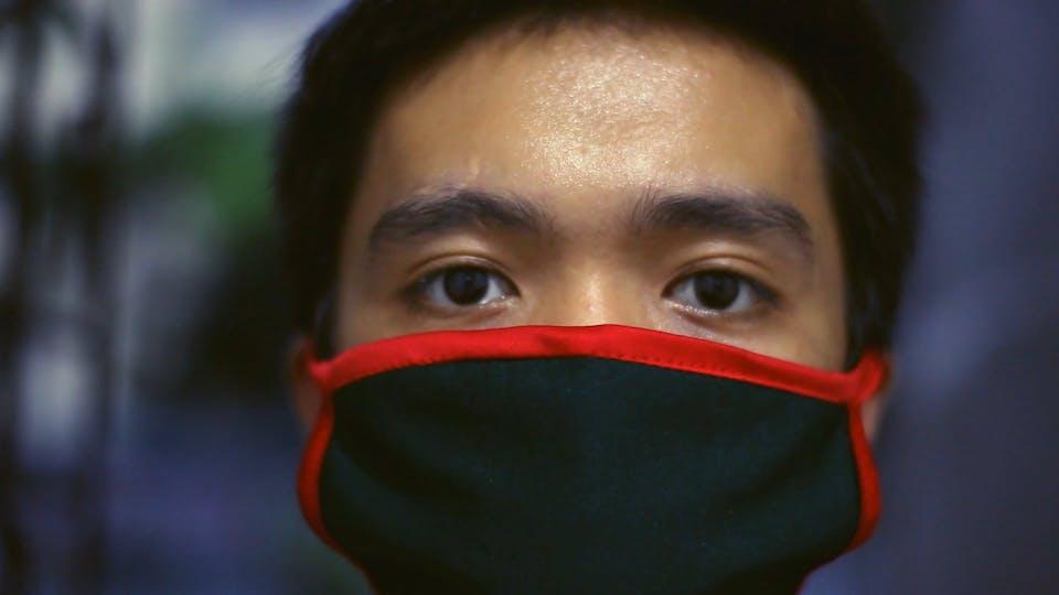 Man Wearing Facemask Looking At Camera