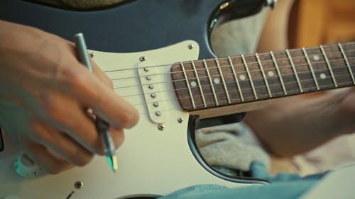 Guitarist Playing Guitar Notes
