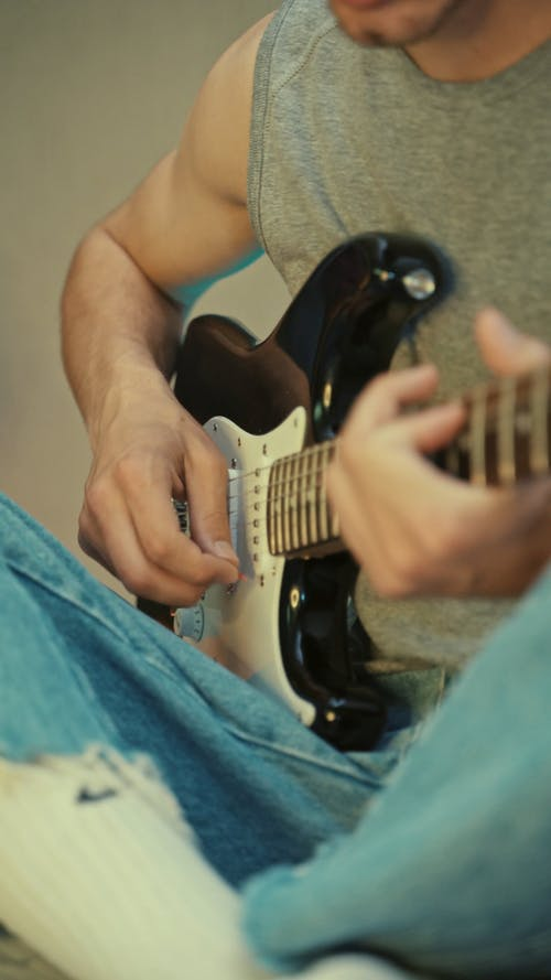 Guy in his Teenage Playing Guitar