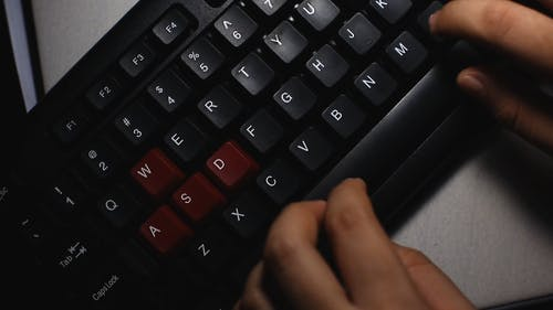 Aerial View of a Person Typing on Computer Keyboard