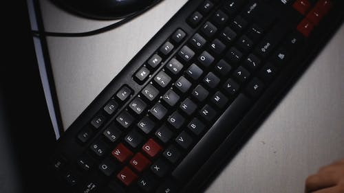 Top View Clip of Person Typing on a Computer Keyboard