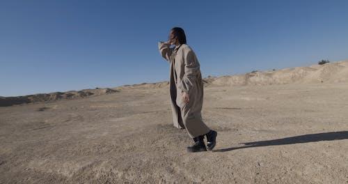A Man Modeling in the Desert