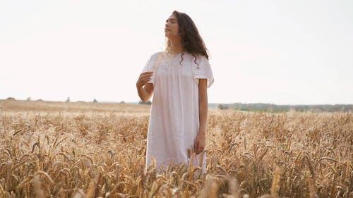 A Beautiful Woman in a Wheat Field