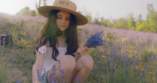 Cute Girl Handpicking Lavender Flowers