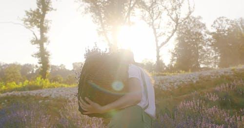 Back View Video Shot of Woman in Flower Fields