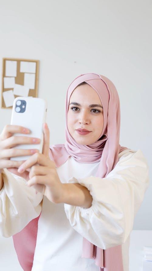 Woman in Pink Hijab Talking a Selfie