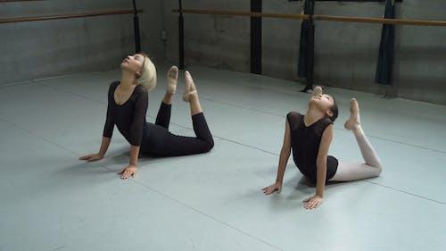 Ballet Dancers Bending Their Body