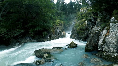 A Huge Water Stream Coming out of Mountains