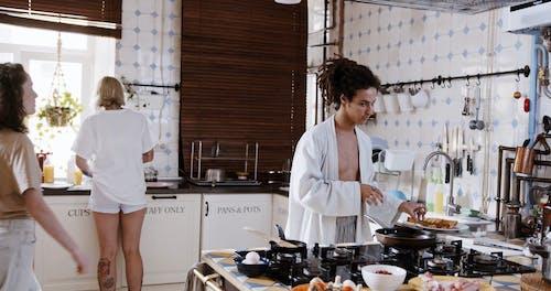Friends Preparing Breakfast