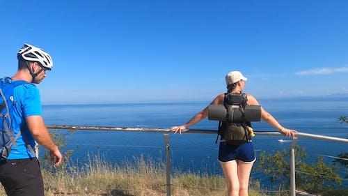 Backpackers Enjoying Beautiful Sea View