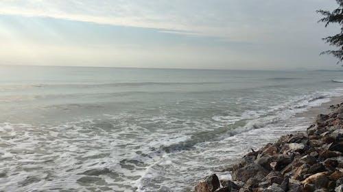 Strong Waves Crashing The Sea Wall Rocks