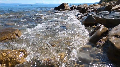 Soft Waves Breaking On The Rocky Shore