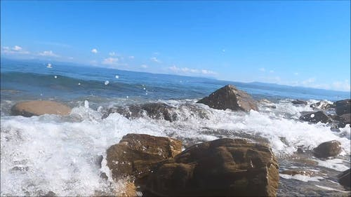 Waves Breaking Over The Rocky Shore